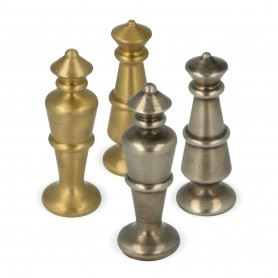 Classic chess pieces stylized in turned brass metal and finished by hand